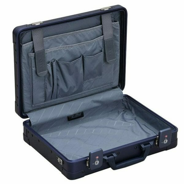 Opened aluminum briefcase with compartments for storage and organization