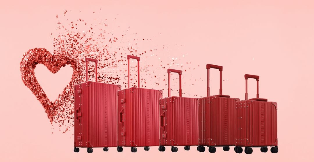 all red aluminum luggage