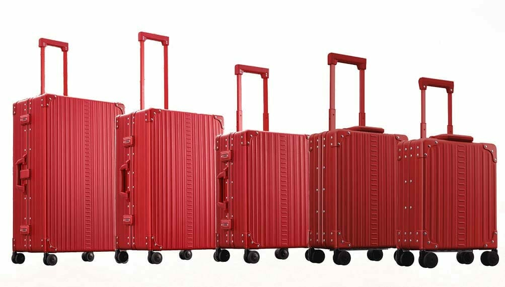 All red carry on luggage made with aluminum from 21 inch carry on to 16 inch under the seat carry on